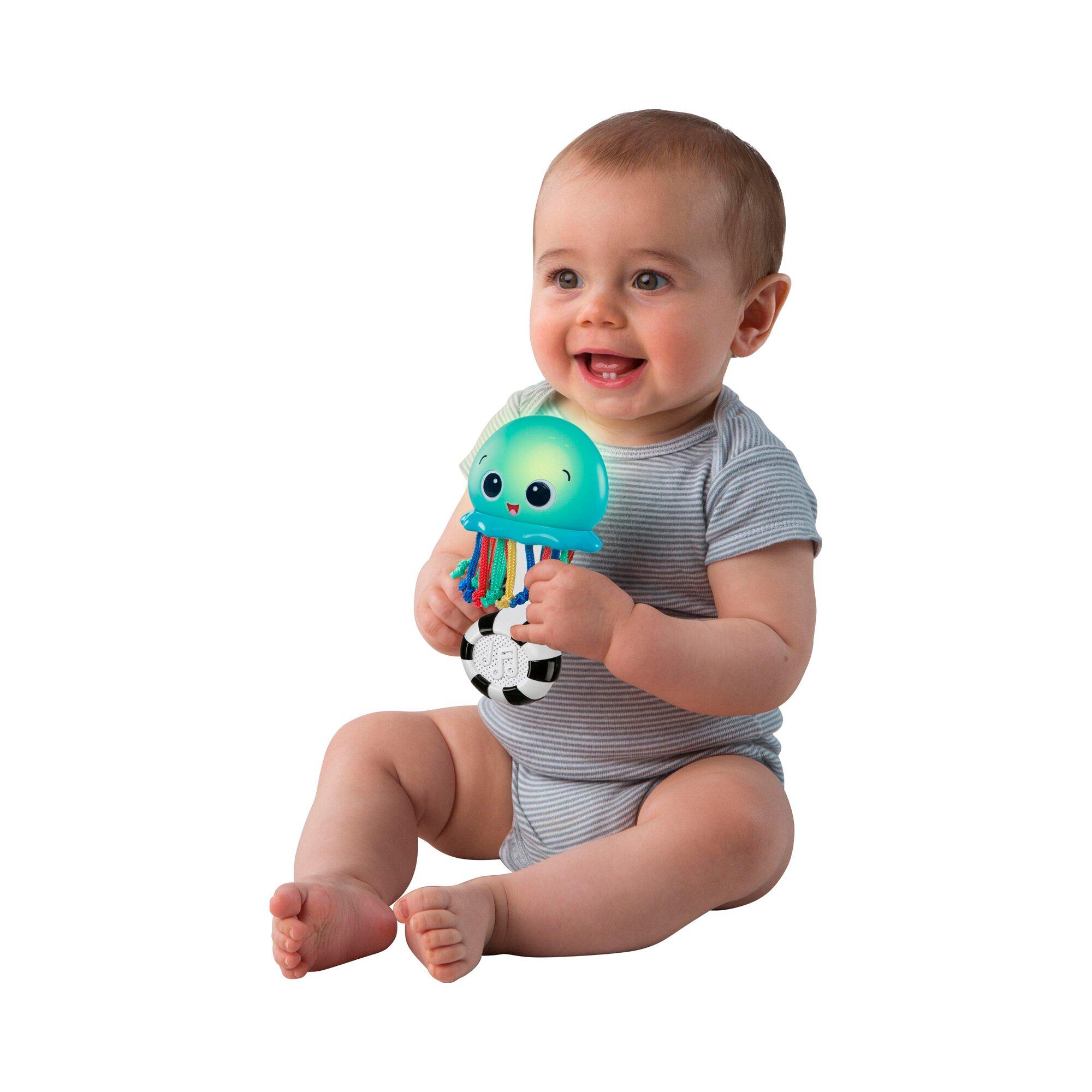 baby-einstein-musikspielzeug-leuchtender-tintenfisch-ocean-glow-sensory-shaker-